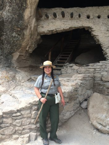 Park Ranger DeAnn Casimiro stands in front of ruins.