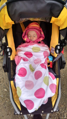 baby bundled up for winter weather in a jogging stroller