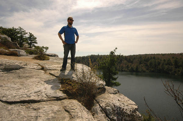 Man standing on rocks high above the lake at Minnewaska Park