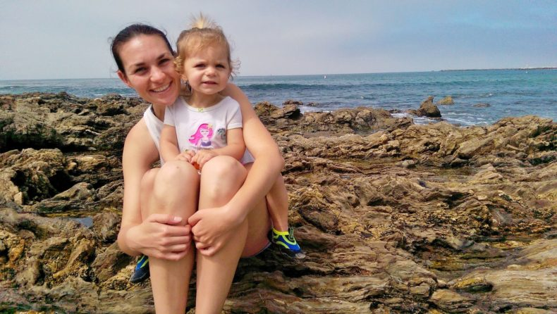 Hiking with a Hearing Loss by Vanessa Wright for Hike it Baby (mom and daughter on a rocky coast line by an ocean)