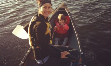 woman and small child in a canoe on a lake