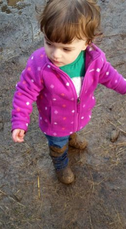 Young girl with muddy boots and jeans