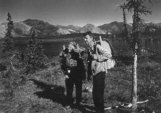 A black and white photo of the Murie's when they were young hikers
