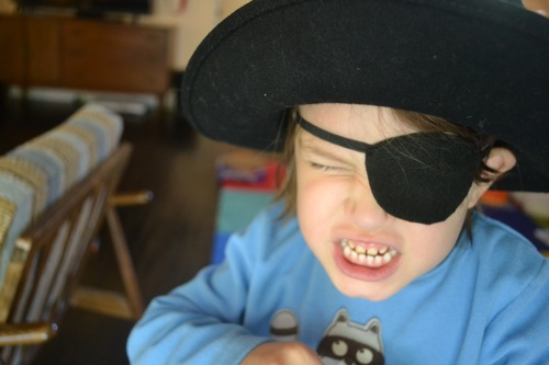 Kid with an eye patch and a pirate hat on