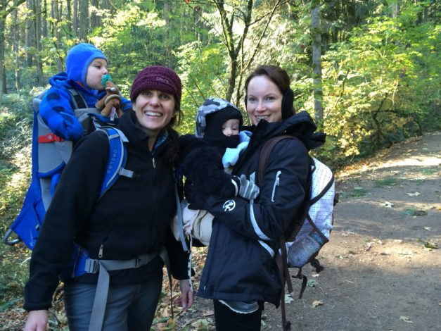 2 women and 2 babies bundled up to go hiking on a 30 degree day
