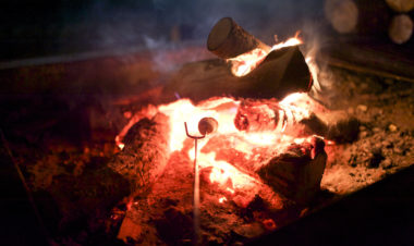 Nighttime Activities for Camping with Kids by Mary Flynn for Hike it Baby (image of a marshmallow roasting over a fire)
