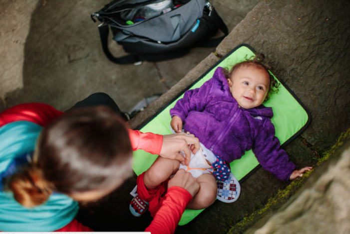 Cloth Diapering while Hiking by Andrea Zimmer for Hike it Baby (image of a baby getting a cloth diaper change)
