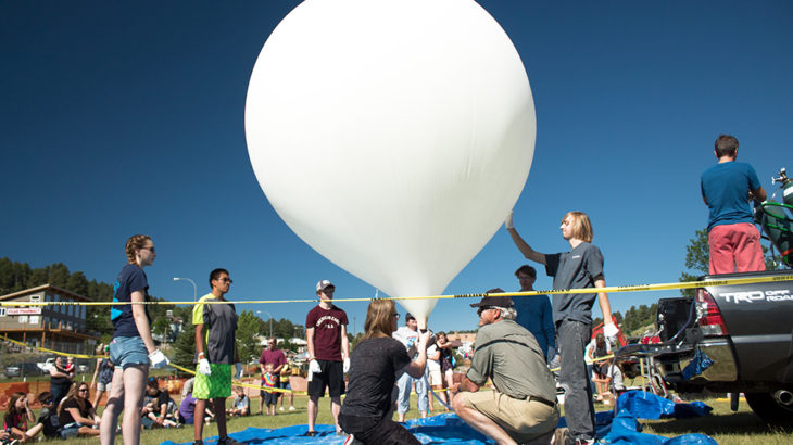 A team prepares to launch a practice NASA weather balloon on July 8, 2017, in Lead, South Dakota.