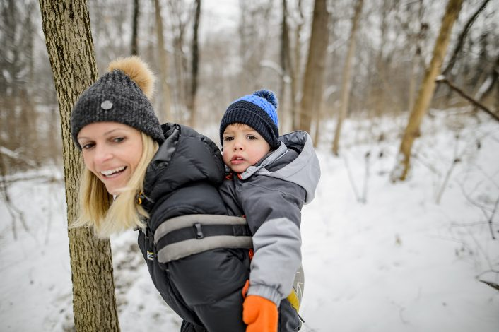mom with child in carrier on a winter hike