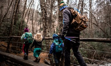 man walking in the woods with his kids