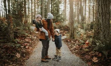 mom with son and daugher on a hiking path in woods