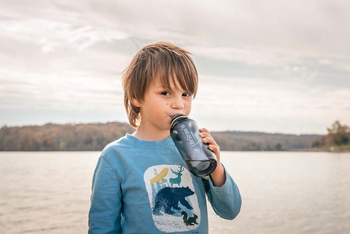 boy using a water filter bottle for hydration