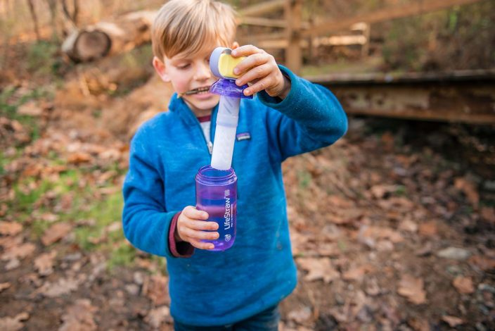 boy with water filtration bottle