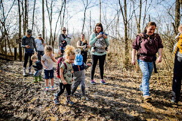 group of parents and young children hiking