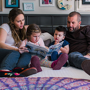 family reading a children's book together