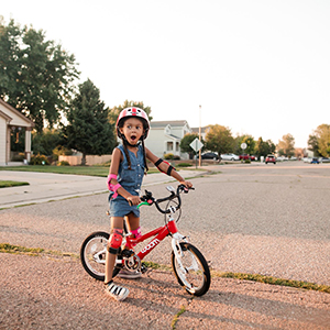 young kind on a bike excited to explore