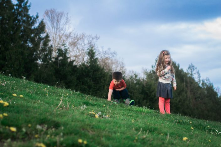 young kids playing in the grass