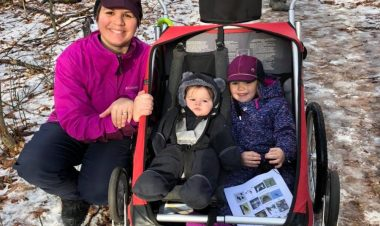 mom with kids in running stroller