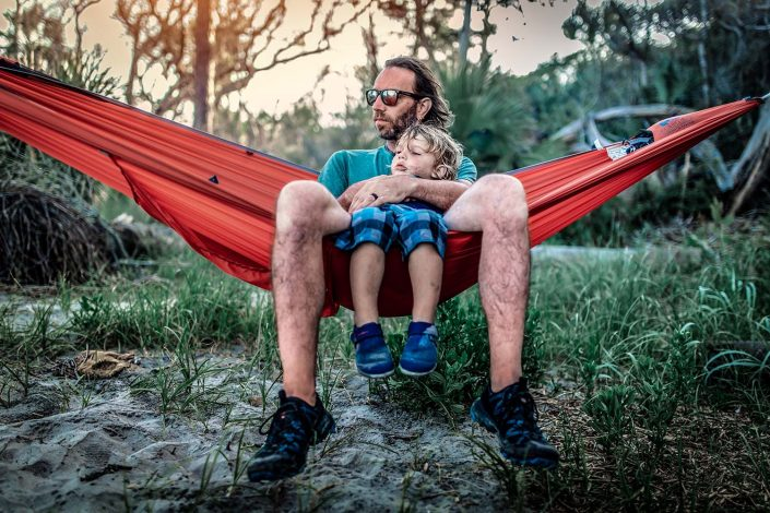 Dad and son in a hammock
