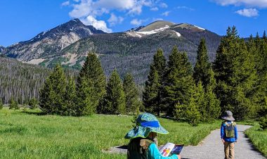 kids in rocky mountain national park with junior ranger booklets