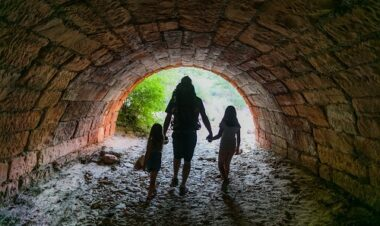 family walking through tunnel